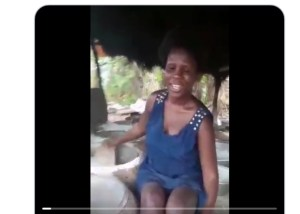 Industrious blind woman stuns people after being filmed frying garri to pay for her school tuition (video/photo)