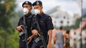 Malaysian police officers mandated to get COVID-19 vaccine or quit