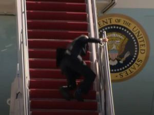 Joe Biden falls over multiple times trying to climb stairs to board Air Force One