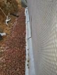 detalle aislamiento en losa para continuar con aislamiento de muro