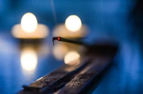 Placing the incense stick in the holder