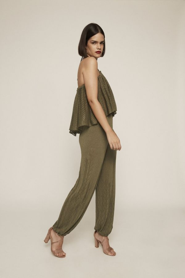 An absolute show-stopper. Dare to wear this draped tail-hem green knit crop top, which features a see-through texture and V strap