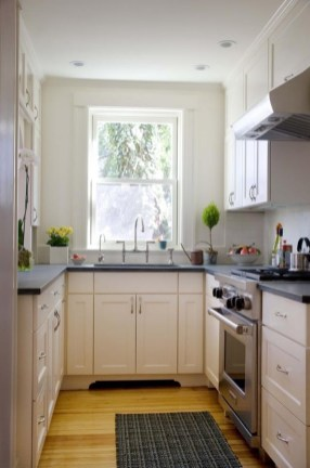Best Creative Small Kitchen Design And Organization Ideas with White Cabinet and Dark Grey Countertop