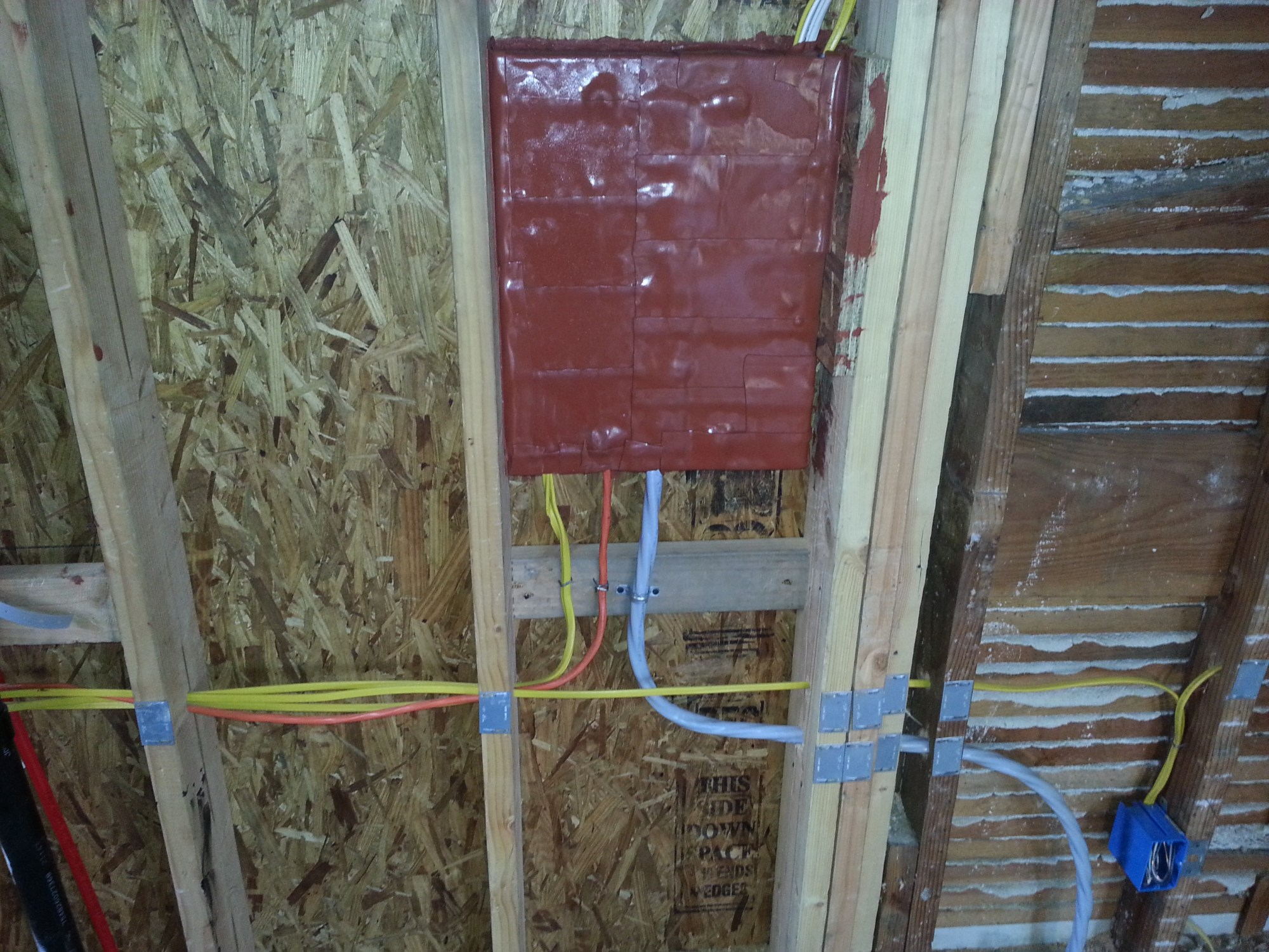 hight resolution of panel is covered with fire pads because the wall is fire rated wall facing the garage