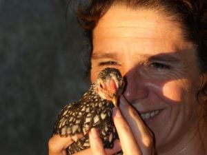 Woman holding a young rooster