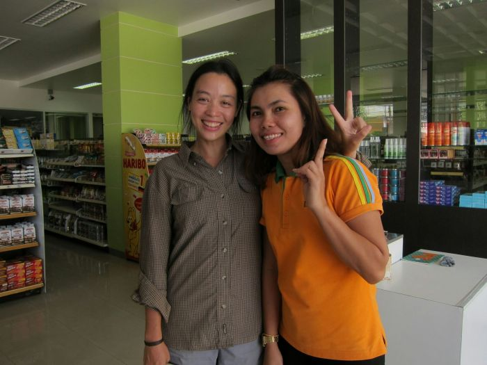 """This is Om, who worked at Limpipong, a fancy-ish miniature supermarket that we found ourselves at almost daily. """"You look like each other"""", Om said to us, which is the first time we've heard that..."""