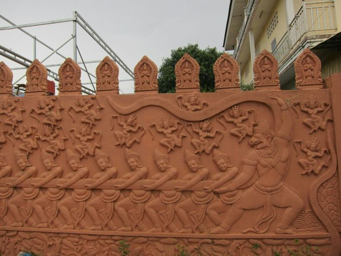 A bas-relief depicting the Samudra manthan or Churning of the ocean of milk in hindu mythology. Long story short: demons and gods tug at opposing ends of a snake that is wrapped around a mountain. The mountain rotates, and eventually extracts the nectar of immortality, among other things.