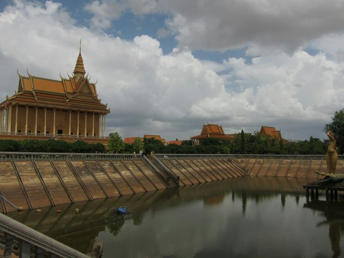 A big square lake, centred by a huge statue of Ganga standing on a massive alligator. The grand golden hall looms to the left