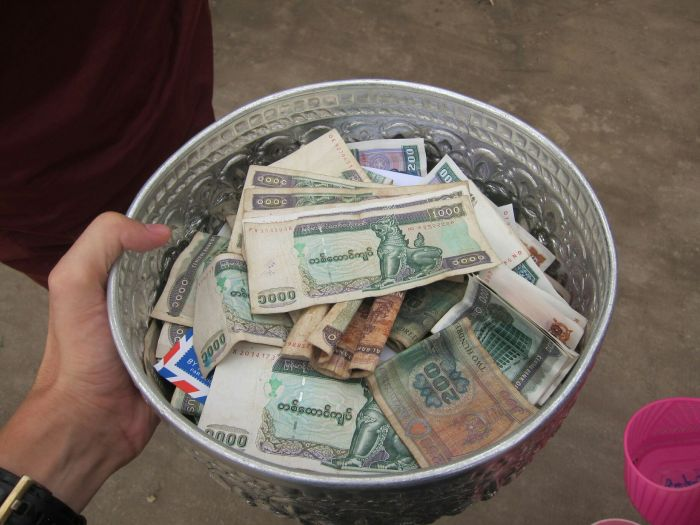 The money bowl at the end of the collection. It was roughly 100 USD, which is a decent amount in Myanmar.