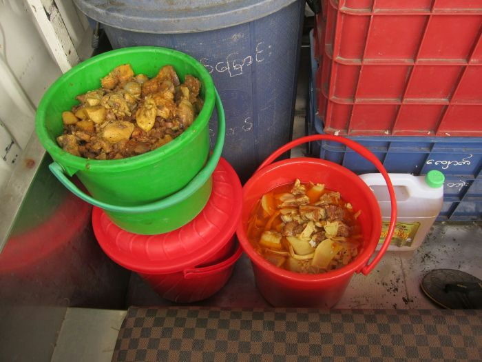 Many people gave big bowls of cooked food. All the similar food, for instance chicken curries, were lumped together in large buckets.