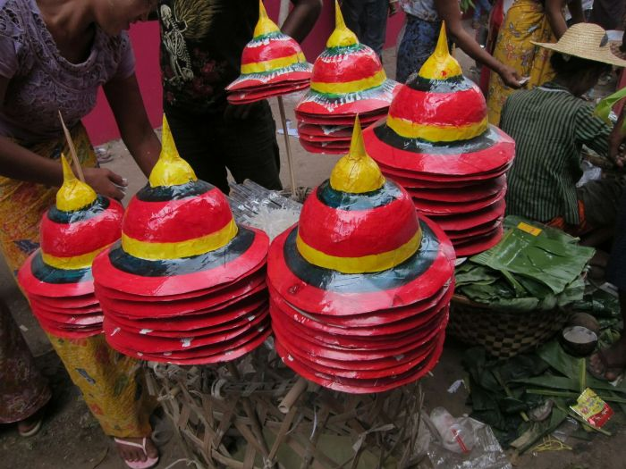 Papier mache hats in the colours of the Myanmar flag