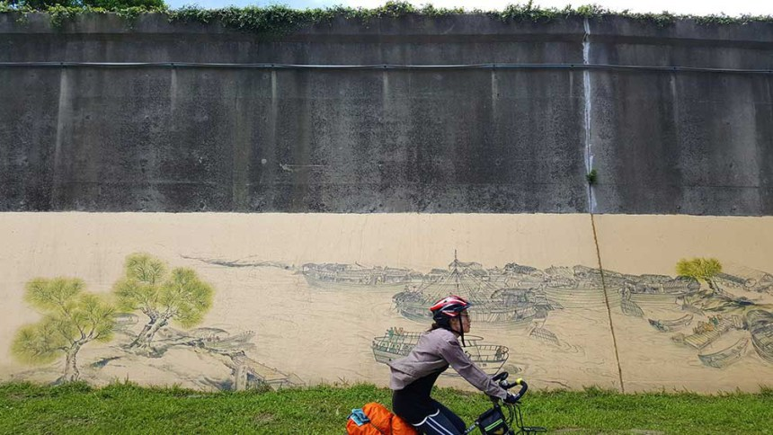 Caroline rides on the Taipei cycleway. There's plenty of artwork along the way.