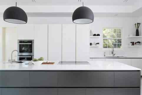 sleek contemporary white and gray kitchen remodel project featured in modern reduction in california home magazine