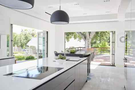 modern bright white and gray kitchen remodel project featured in modern reduction in california home magazine
