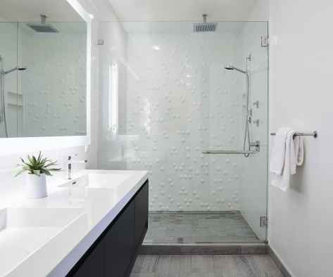sleek white with warm wood bathroom remodel project featured in modern reduction in california home magazine