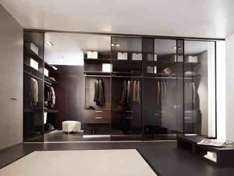 mirrored wall of doors in luxury custom closet by Schmalenbach