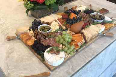Los Angeles-based food stylist, Meg Quinn, presented this rectangular cheese and fruit tray with circular features to create an artistic display