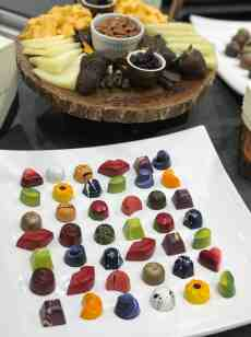 curated art exhibition at eggersmann dallas featured colorful molded chocolates by chocolate secrets