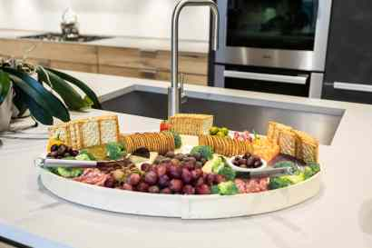 cheese crackers and crudite served to guests of eggersmann kitchens chicago showroom during the rndd gallery walk 2019