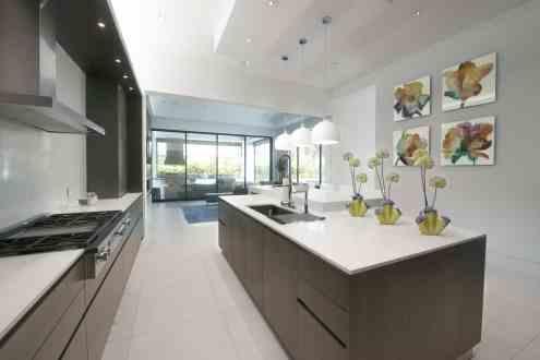 view of ultra modern eggersmann kitchen looking to outdoor kitchen