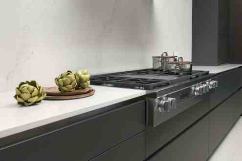 miele stovetop in caesarstone quartz countertop with matching backsplash