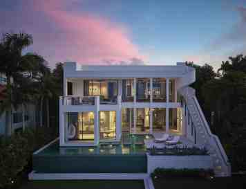 Jernigans' miami home rear facade features an impressive staircase