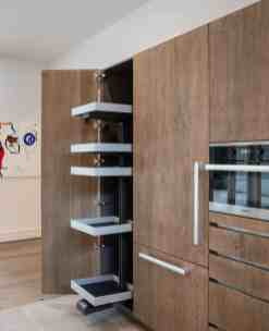 hidden storage in custom german cabinetry in a washington coalition memorial park area home in houston