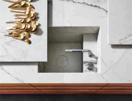 eggersmann MOTION sliding countertop opens to reveal a hidden sink