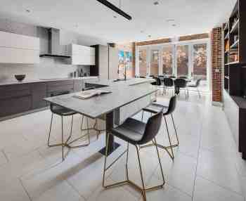 ultra modern handleless kitchen with finishing touches of bespoke luxury furniture