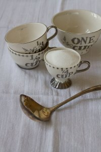 China measuring cups and a silver spoon