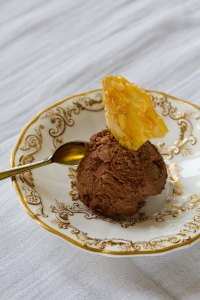 Scoop of chocolate ice-cream with shard of almond brittle
