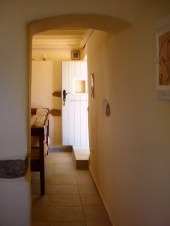 passage between kitchen and living room