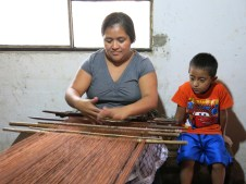 Marta demonstrating the backstrap loom