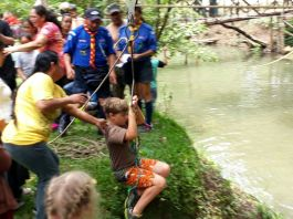 Jacob preparing to 'zip' into the river
