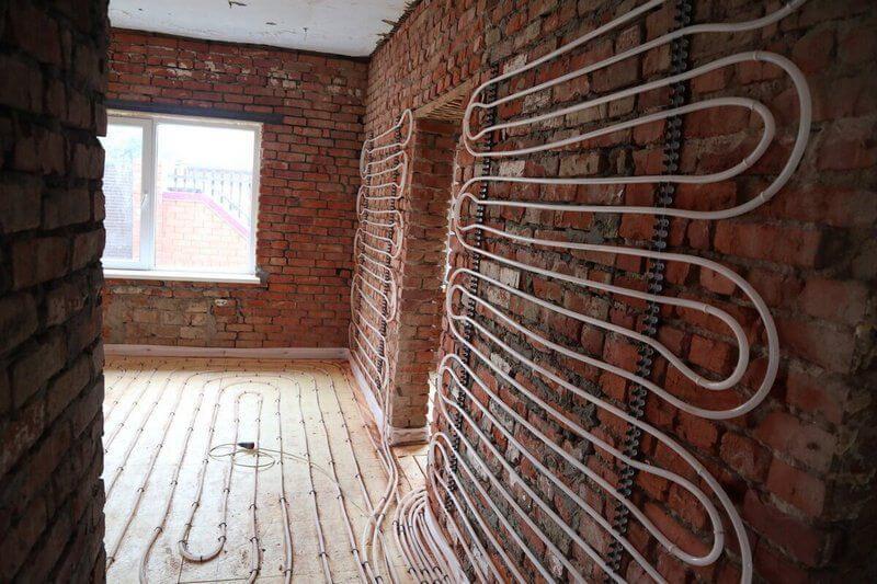 Теплый пол на стене частного дома