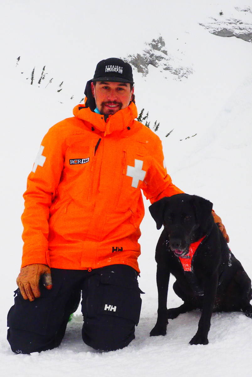 Fernie ski patroller Sean Caira with his six-year-old avalanche rescue dog, Tabor. (Scott Tibballs / The Free Press)