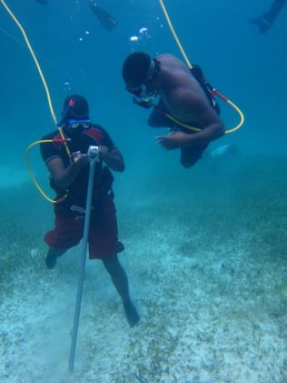 Dwayne and Howard install a buoy at the coral nursery.