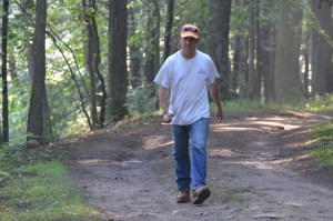 Walking in the woods with a fishing pole