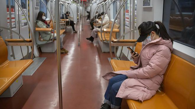 China coronavirus cases now top 20,000; Hong Kong shuts most of ...