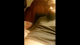 Hot muscular bearded guy jerking his huge dick and moaning