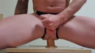 Gay twink takes big dildo in speedos, fisting dildo
