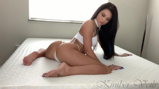 Gorgeous and fit, blue eyed porn star Kimber Veils gives herself a leg shaking orgasm!!
