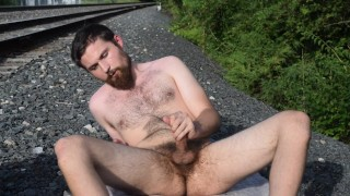 Stroking and Posing Next to Railroad Tracks