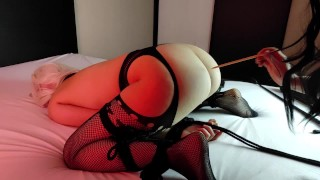 Lesbian mistress puts clothespins on her sub's pussy, spanks and makes cum
