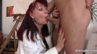 Redhead mature paintress sucking and riding his dick