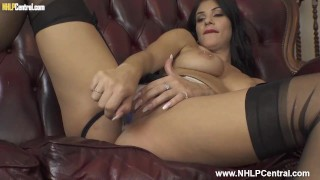Busty brunette Roxy Mendez toys her pussy in sexy panties nylons and high heels