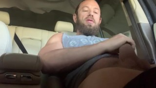 Huge cock sprays out a big load in public parking lot