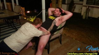 Big Bear fucks tattooed guy OUTDOORS on cottage deck by the CAMP FIRE