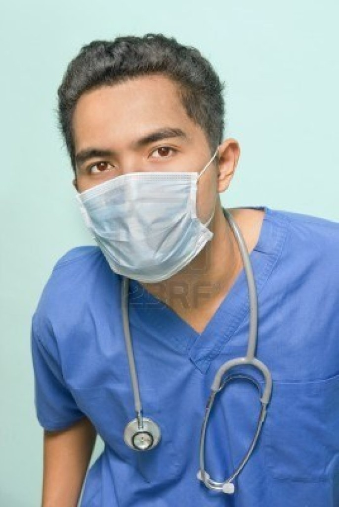 4083859-portrait-of-a-confident-doctor-or-surgeon-in-scrub-suit-with-surgical-mask-over-his-face-and-stethos