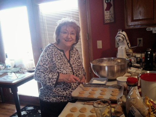 Aunt Betty is happy with how the cookies are coming along.